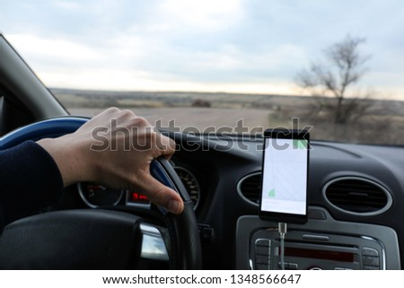 Car driver using mobile phone for navigation #1348566647