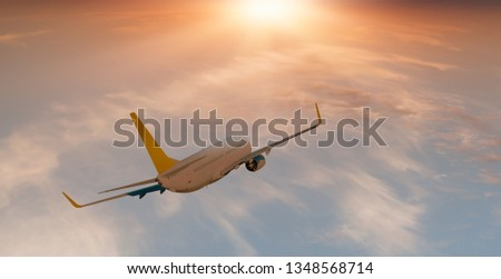 White Passenger airplane in the clouds at sunset - Travel by air transport #1348568714