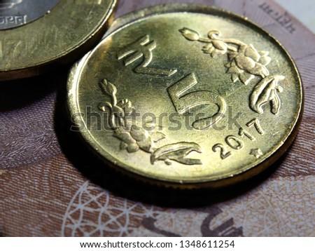 Indian five rupee coin close up shot #1348611254