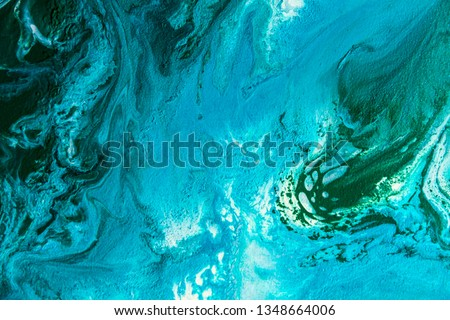 Abstract painting drawn by fluid acrylic technique. Picture with emerald, green, mint colorful water stains, gradients on blue background. Imitation of sea ocean waves on canvas. Modern art concept. #1348664006