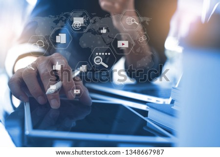 Digital marketing media (website ad, email, social network, SEO, video, mobile app), business strategy analysis concept with modern web icons. Man working on digital tablet in modern office #1348667987