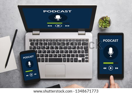 Podcast concept on laptop, tablet and smartphone screen over gray table. All screen content is designed by me. Flat lay