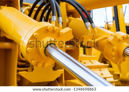Powerful hydraulic cylinders. The main power and driving element for construction equipment. #1348698863