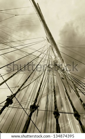 Gear old sailing ship on the background of an overcast sky - Turku, Finland (stylized retro) #134874395