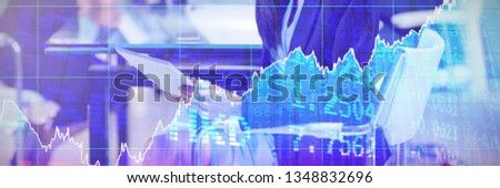 Stocks and shares against businesswoman using digital tablet #1348832696
