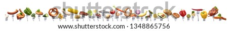 different foods in a row in front of white background  #1348865756