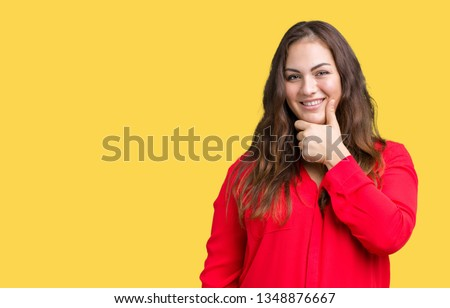 Beautiful plus size young business woman over isolated background looking confident at the camera with smile with crossed arms and hand raised on chin. Thinking positive. #1348876667