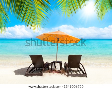 Relaxing under a sunshade with beach chairs #1349006720