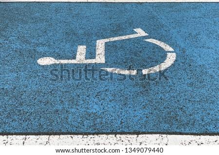 image of sign parking for the disabled on asphalt, close-up #1349079440