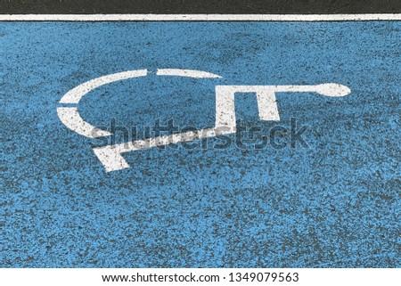 image of sign parking for the disabled on asphalt, close-up #1349079563