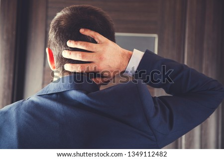 young business man hand in the neck #1349112482