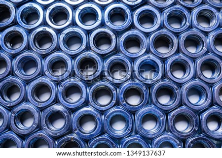 Composition of iron nuts and bolts close-up, texture, background. Industry, industry. #1349137637