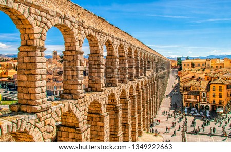 Ancient Roman aqueduct on Plaza del Azoguejo square and old building towns in Segovia, Spain. #1349222663