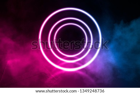 Background of empty stage, room. Reflection on wet pavement, concrete. Neon blurry lights. Neon circle figure in the center, smoke #1349248736
