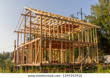 wooden interior frame of a new house under building, architectural residential construction stick built home framework. #1349343416