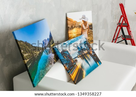 wall art canvas in three parts. Sofa, in room interior. Royalty-Free Stock Photo #1349358227