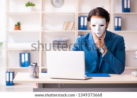 Male employee in the office in industrial espionage concept #1349373668