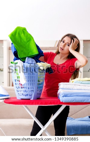 Young beautiful woman ironing at home #1349390885