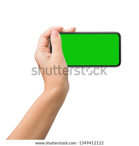 Man holding cellphone in landscape mode with green chroma key screen isolated on white background