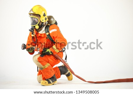 Firefighter with fire fighting equipment and accessories on white background
