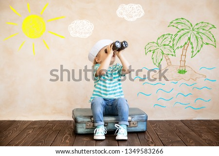 Happy child pretend to be sailor. Funny kid playing at home. Summer vacation and travel concept #1349583266