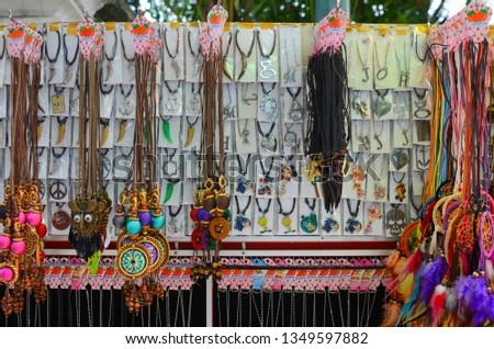 Yogyakarta, Indonesia - March 21, 2019 :  souvenir necklace in the tourist area of Yogyakarta  #1349597882