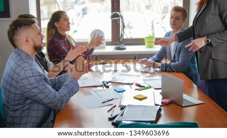 Business concept. A working team at the conference clapping their hands #1349603696