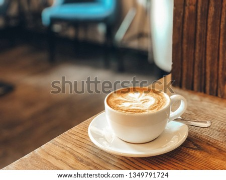 A cup of beautiful coffee, cappuccino cup, latte art, coffee art #1349791724