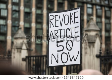 Revoke article 50 Anti-Brexit banner at a march in London #1349847920