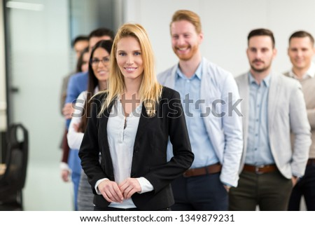 Portrait of business team posing in office #1349879231