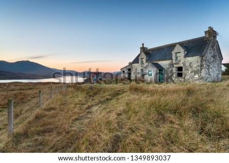 A derelict cottage on the Isle of Lewis in the Outer hebrides of Scotland Royalty-Free Stock Photo #1349893037