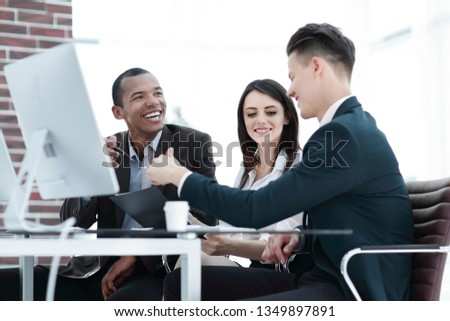 business team working together at desk in creative office #1349897891