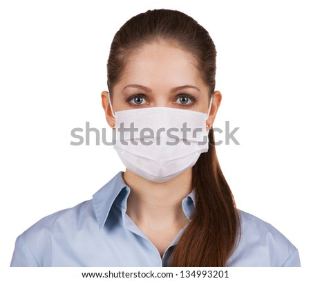 Young long-haired woman in protective medical mask #134993201