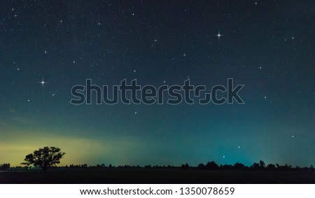 Panorama blue night sky milky way and star on dark background.Universe filled with stars, nebula and galaxy with noise and grain.Photo by long exposure and select white balance.Dark night sky. #1350078659