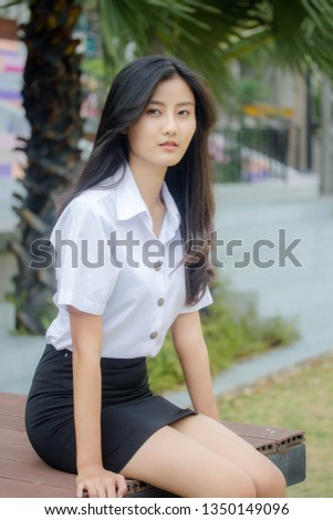 Portrait of thai adult student university uniform beautiful girl relax and smile #1350149096