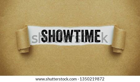 Torn brown paper revealing the word Showtime #1350219872