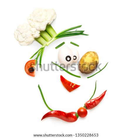 Creative diet food healthy eating concept photo of a funny cartoon chef made of pepper cabbage fresh fruits and vegetables full of vitamins on white background.