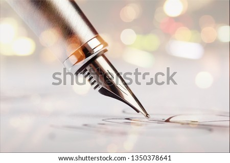 Signing a signature with a fountain pen #1350378641