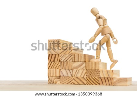 Wooden staircase and wooden doll against white background with free space for further editing #1350399368