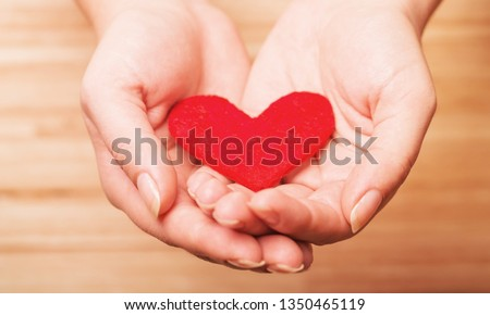 Hands holding red heart #1350465119