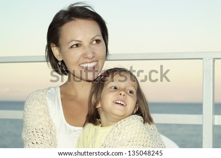 portrait of young happy woman with a young daughter on vacation #135048245
