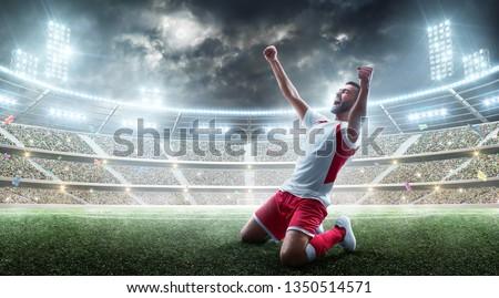 Soccer wins. Professional soccer player celebrates winning the open stadium. Sport.  #1350514571