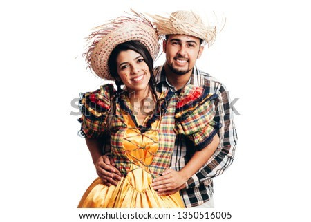 Brazilian couple wearing traditional clothes for Festa Junina - June festival - dancing isolated on white background #1350516005