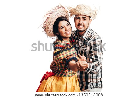 Brazilian couple wearing traditional clothes for Festa Junina - June festival - dancing isolated on white background #1350516008