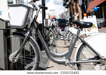 Bicycles or bikes available in a city for rent #1350532682