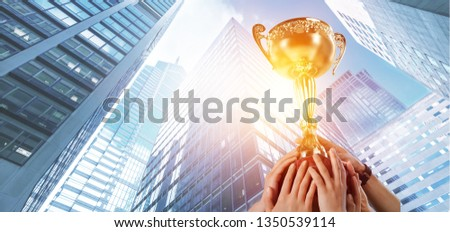 The victory. The winner team's pride. Businesses are competing for team appreciation award, organizations or individuals succeed.          - Image #1350539114