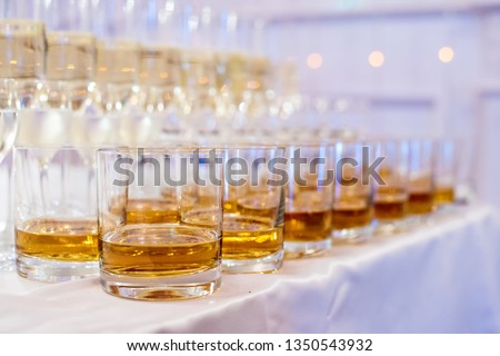Alcoholic and non-alcoholic beverages. The party is just beginning. Rows of glasses with drinks. #1350543932