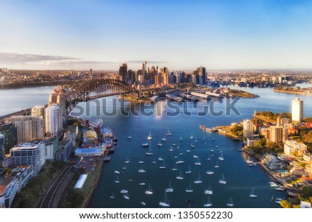Sydney harbour around Lavender bay off North Shore towards major city CBD landmarks around the Sydney Harbour bridge in elevated aerial view. Royalty-Free Stock Photo #1350552230