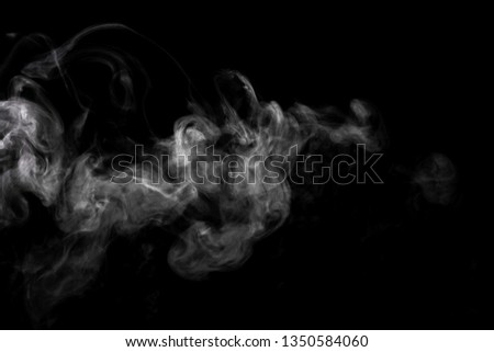 Abstract powder or smoke effect isolated on black background #1350584060