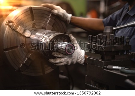 Professional workers are doing the milling process for metal parts, metal machinery in large industrial plants-image Royalty-Free Stock Photo #1350792002